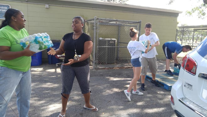 More than two tons of water donated by Blankets & Blessings were unloaded at the Charleston Park Community Center on Saturday.
