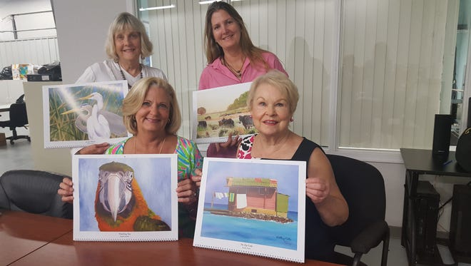 Some of the artists featured in the 2018 Art for Living calendar are from left, Susie Fowler and Kathy Pitts, seated, and Ginny Jones and Susan Roberts, standing.