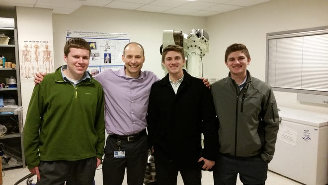 Sean Doran, (left to right), Dr. Carl Imhauser, Michael Dowling and James Dowling participate in Immaculata's Career Shadowing Program at the Hospital for Special Surgery in New York.