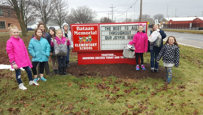 Bataan Memorial Elementary School's Clean Up Club took care of the Bataan neighborhood. Students participating in a recent cleanup are , from left, Marleta Chasteen, Makayla Swanson, Braylin Anderson, Jenna Anderson, Alexis Stark, Ava Carr, Lily Mincer, Emily Dible, and Morgan Lempke.