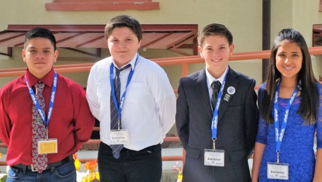 From left, are Dace Begay, Adam Senter, Lane Porter and Hannah Abeyta. The four Jose Barrios Elementary students participated in the state science and engineering fair.