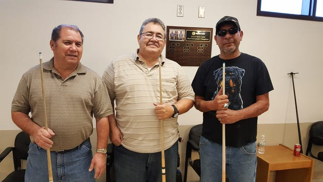 Pictured from left to right are the March 2018 winners of the Munson Senior Center monthly 8-ball billiard's tournament: JR Guevara of Organ, New Mexico took first place, John Arsola of Las Cruces took second place and Carlos Hernandez of Las Cruces took third place.
