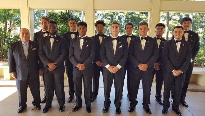 The 11 finalists for the National Football Foundation Collier County chapter's 2018 scholarships. Front row (left to right): Chapter president Matt Sellitto, Israel Anis (Community School), Anthony Robinson (Golden Gate), Andre Eaton (Naples), Will Glasser (St. John Neumann), Elias Cuevas-Gonzalez (Immokalee); Back: Kaden Frost (Gulf Coast), Daniel Marquina (First Baptist), Bailey Anderson (Palmetto Ridge), Jacob Kuhlman (Barron Collier), Hakeen Durity (Lely), Brenden Howard (Marco Island Academy).