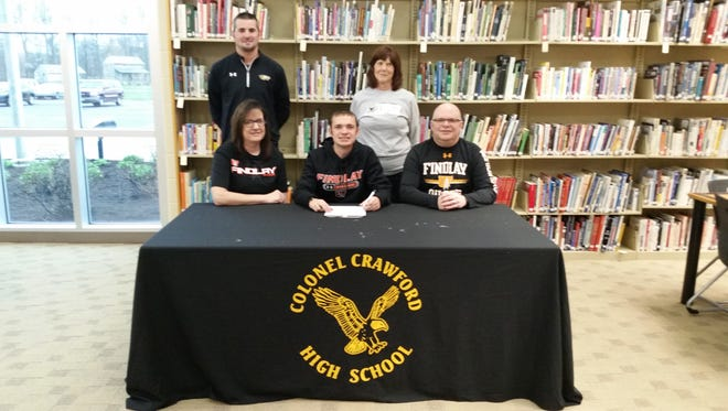 Wade Hopkins, surrounded by his parents Cindy and Sam, as well as his coaches Preston Foy and Jody Grove.