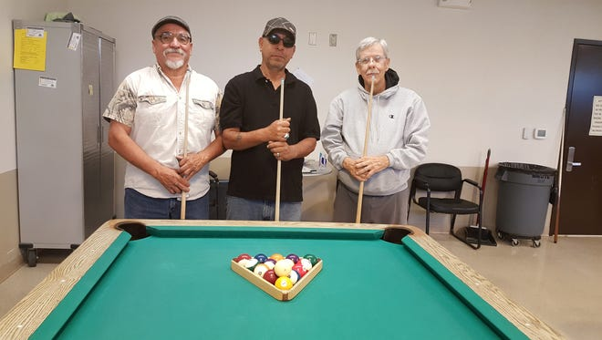 The winners of Munson Senior Center's monthly 8-ball billiard's tournament from left to right: Teddy Sedillo in first place, Carlos Hernandez in second place and Pete Kinny in third place.