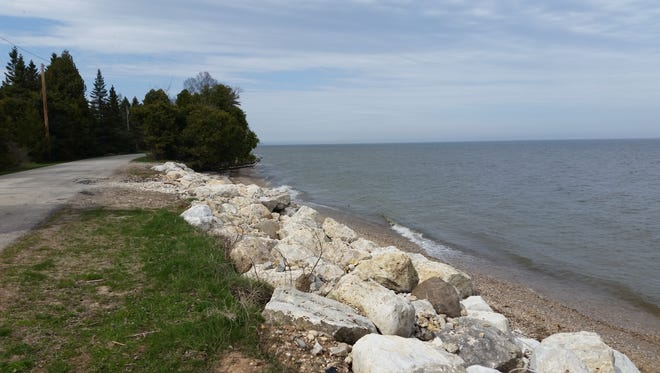 Newly-placed rocks help curb erosion on South Lake Michigan Drive in Clay Banks.