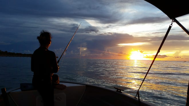 Photo of the week winner Alan San Nicolas captured this photo of his wife fishing during sunset in Merizo .
