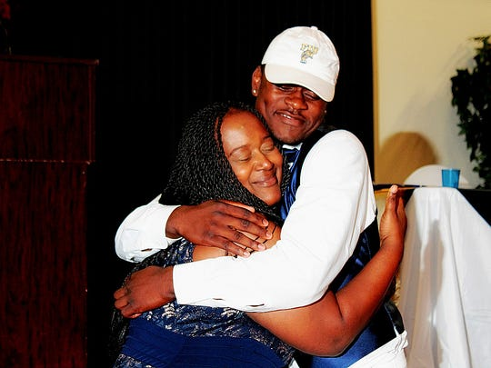 Rocky Jacques-Louis hugs his mother Valerie Church after he signed with FIU at a ceremony at the Dr. Carrie Robinson Event Center on Wednesday.
