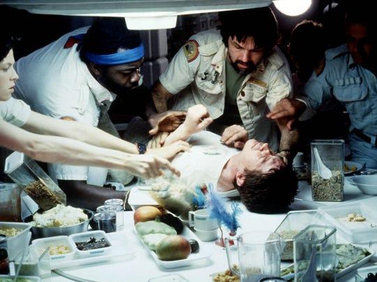 "In 1979's ""Alien,"" the death of Kane (John Hurt, on table) shocked movie audiences. Sigourney Weaver (from left), Yaphet Kotto, Tom Skerritt and Ian Holm also star."