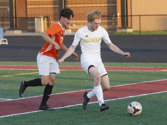 Ankeny defender Ryan Kueker tries to clear the ball