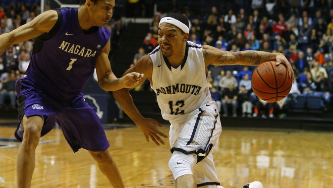 Monmouth Hawks guard Justin Robinson (12) drives to the basket against Niagara in the Hawks regular-season finale.
