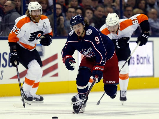 Columbus Blue Jackets forward Artemi Panarin, center, of Russia, chases the puck ahead of Philadelphia Flyers forward Jakub Voracek, left, of the Czech Republic, and defenseman Philippe Myers during the second period of an NHL hockey game in Columbus, Ohio, Thursday, Feb. 28, 2019. (AP Photo/Paul Vernon)