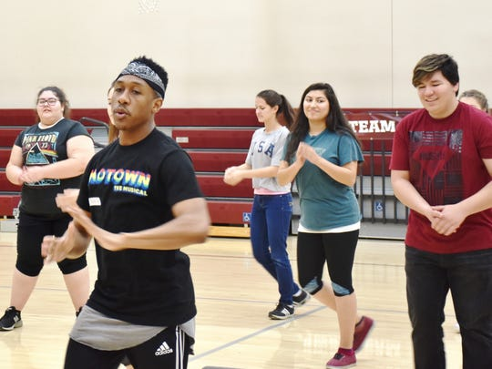 "A member of ""Motown the Musical"" shows a group of Coachella Valley theater students a few moves."