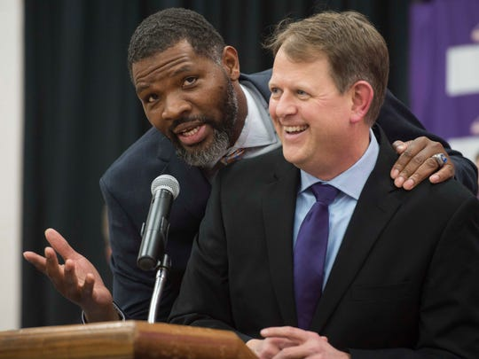 "University of Evansville head coach Walter McCarty interrupts UE Senior Associate Athletic Director Lance Wilkerson's closing remarks to remind fans to ""get on board"" at Meeks Family Fieldhouse on Friday, March 23, 2018. McCarty, an Evansville native was announced as the new University of Evansville mens basketball coach Thursday."