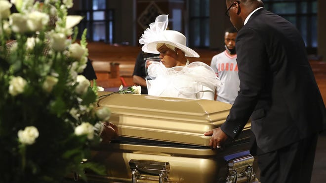 Tomika Miller helps funeral workers close the cover of the casket of her husband, Rayshard Brooks, at the conclusion of his public viewing at Ebenezer Baptist Church on Monday, June 22, 2020, in Atlanta. Brooks, 27, died June 12 after being shot by a white police officer in a Wendy's parking lot.