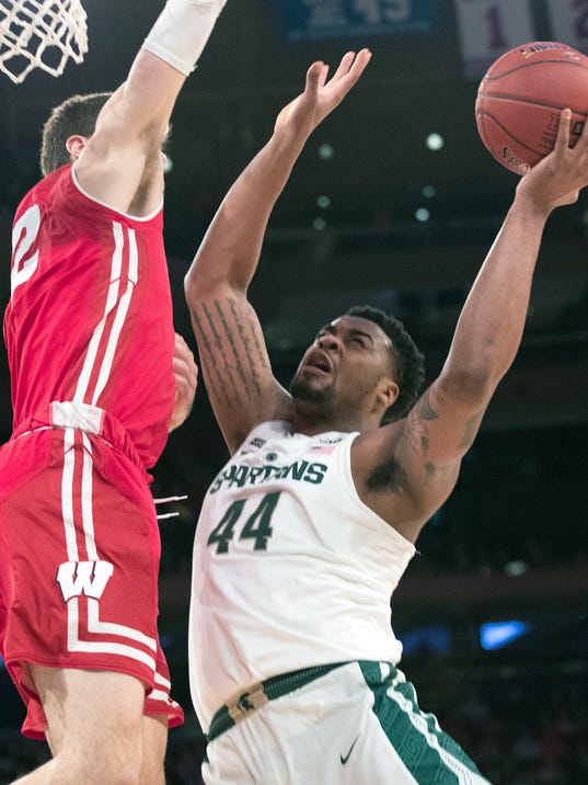 Michigan State forward Nick Ward (44) goes to the basket against Wisconsin forward Ethan Happ (22) during the first half of an NCAA college basketball game in the quarterfinals of the Big Ten conference tournament, Friday, March 2, 2018, at Madison Square Garden in New York. (AP Photo/Mary Altaffer)