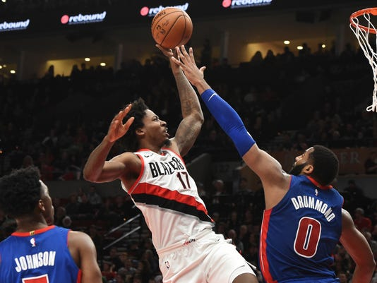 Portland Trail Blazers forward Ed Davis, right, drives to the basket on Detroit Pistons center Andre Drummond as Pistons forward Stanley Johnson, left, watches during the second half of an NBA basketball game in Portland, Ore., Saturday, March 17, 2018. The Blazers won 100-87. (AP Photo/Steve Dykes)