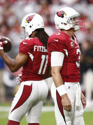 Arizona Cardinals Carson Palmer and Larry Fitzgerald warmup before playing the San Francisco 49ers in the first half on Sep. 27, 2015 in Glendale, AZ.