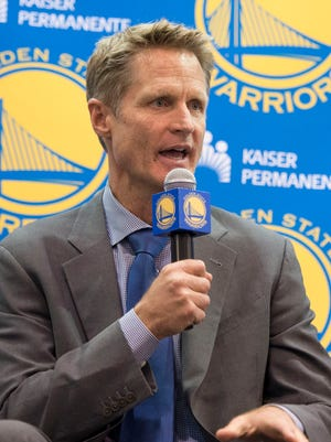 New Warriors coach Steve Kerr speaks with the media Tuesday at his introductory news conference in Oakland.
