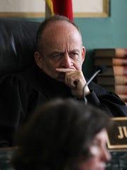 Judge Curt Hartman listens to a statement from Monika