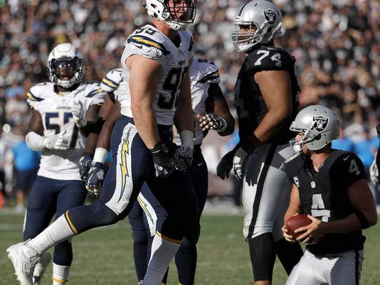 San Diego Chargers defensive end Joey Bosa (99) celebrates after sacking Oakland Raiders quarterback Derek Carr (4) during the second half of an NFL football game in Oakland, Calif., Sunday, Oct. 9, 2016. (AP Photo/Marcio Jose Sanchez)nam th ja mx au nz