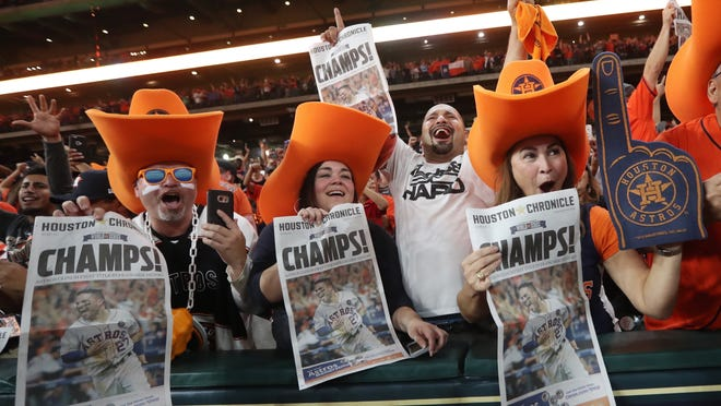 David Arriasola, from left, Jennifer Reyna, Jesse Montalvo and Debbie Brannon celebrate after the Houston Astros won Game 7 of baseball's World Series between the Los Angeles Dodgers and the Astros at at Minute Maid Park in Houston on Wednesday, Nov. 1, 2017. (Jon Shapley/Houston Chronicle via AP) ORG XMIT: TXHOU306