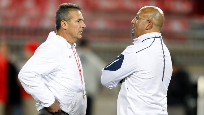 Ohio State football coach Urban Meyer, left, and Penn State coach James Franklin meet on the field before a game Oct. 17, 2015.