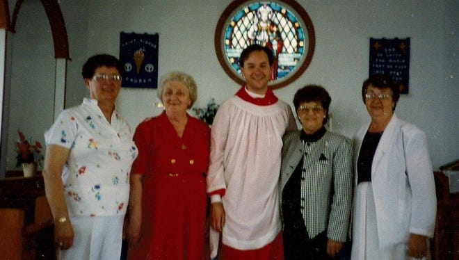 Kyle Ritter stands with his traveling choir in Newfoundland, from left, Rhoda Payne, Irene Hutchins, Kyle, Gertie Woods (visiting from Indiana) and Annie Pittman. All but Gertie shared the bench seat of his truck as they traveled the Newfoundland coast.
