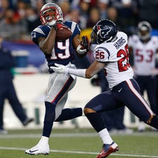 FOXBORO, MA - DECEMBER 10:  Donte' Stallworth #19 of the New England Patriots beats Brandon Harris #26 of the Houston Texans to a pass and runs the ball into end zone for a touchdown in the second half at Gillette Stadium on December 10, 2012 in Foxboro, Massachusetts. (Photo by Jim Rogash/Getty Images)