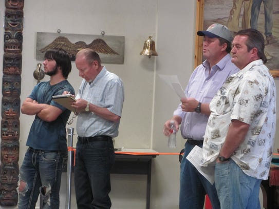 A group of potential auction bidders, including Richard