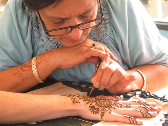 Parwin Pothiawala, 59, an Essex Junction-based henna