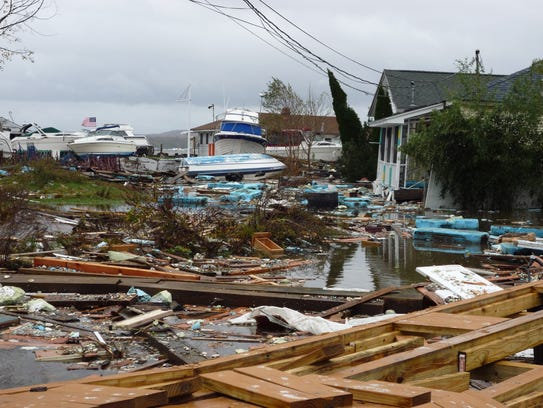 Debris-filled ground on Beach Road in Stony Point in