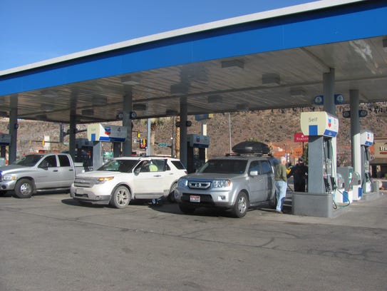 Visitors gas up at a station in St. George.
