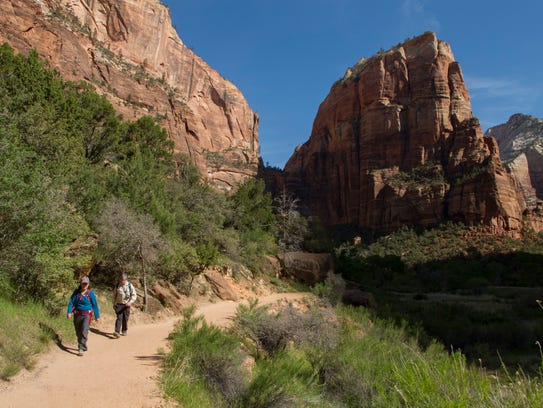 Hikers walk along the West Rim Trail as Angels Landing