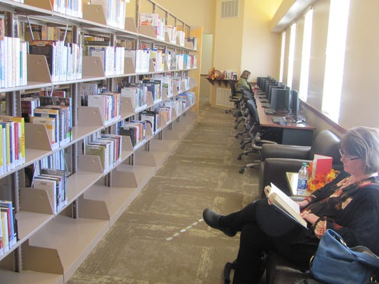 Patrons at Hildale's new public library read during