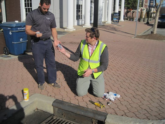 Stuart Wine, left, and Nathan Hinkle install stormwater