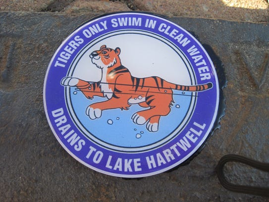 Customized stormwater drain markers were installed