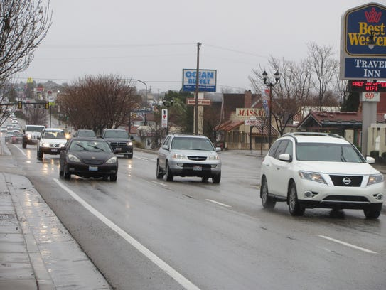 Drivers travel a rainy downtown St. George Boulevard