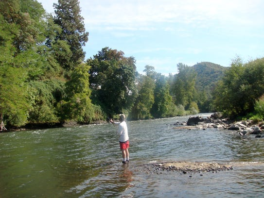 Gay Urness fishes for trout near Valley of the Rogue