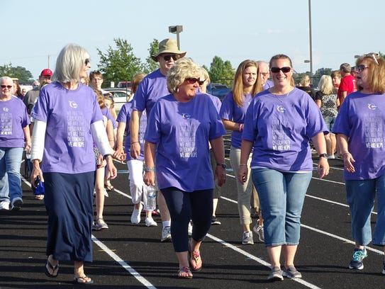 """Wearing purple """"survivor"""" shirts, people who have battled"""