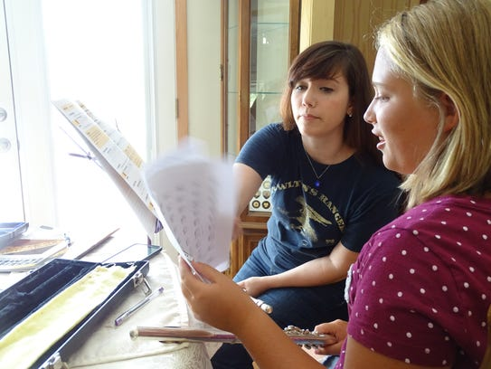 Marissa Stephens, right, took her second flute lesson