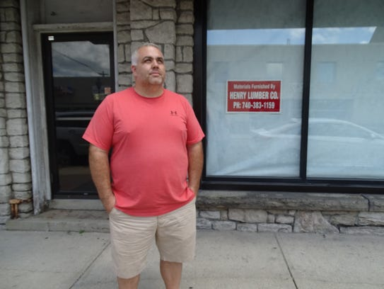Mike Henry, owner of Henry Lumber Company, plans to
