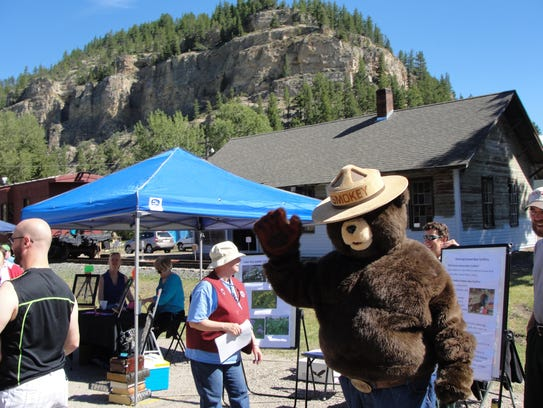 Smokey the Bear waves from the Monarch Rocks! Festival.