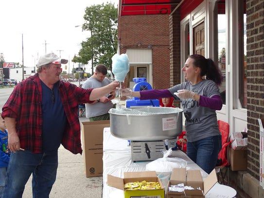 Jennifer Tackett sold cotton candy outside OK Cafe