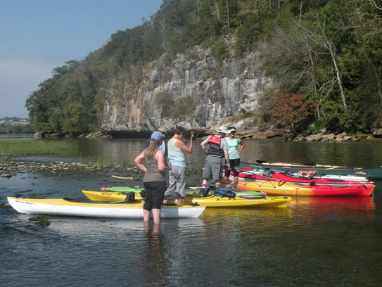 Kayakers take a break during  a 10-mile trip down the