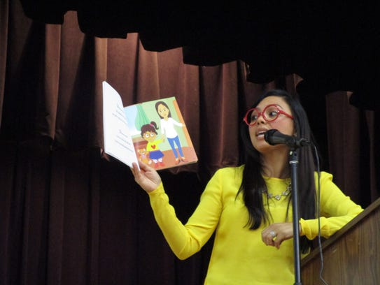 Author Diana Lee Santamaria reading to students from