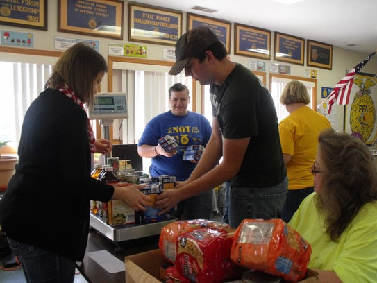7224: Jake Troyer sorts donations along with his mother,