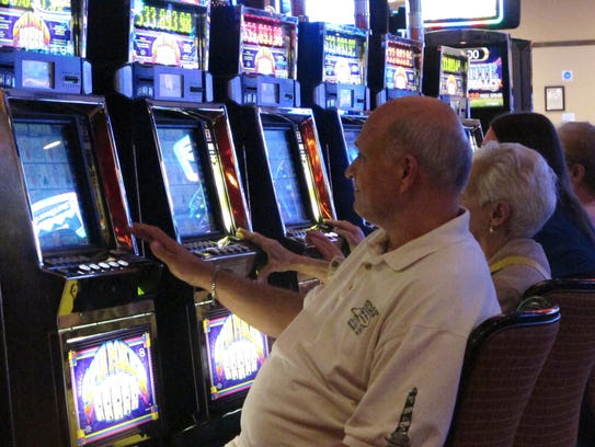 Gamblers play slot machines at the Golden Nugget casino
