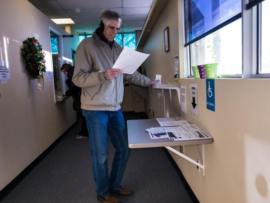 Middletown resident Rich O'Connor pays his property