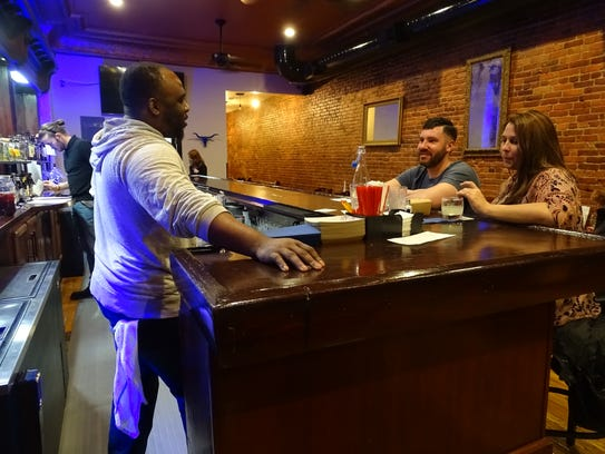 Derek and Andrea Mullins talk with bartender Bryson Faggs at Tres, a Mexican-style restaurant in downtown Marion, on the night of Jan. 23, 2018.